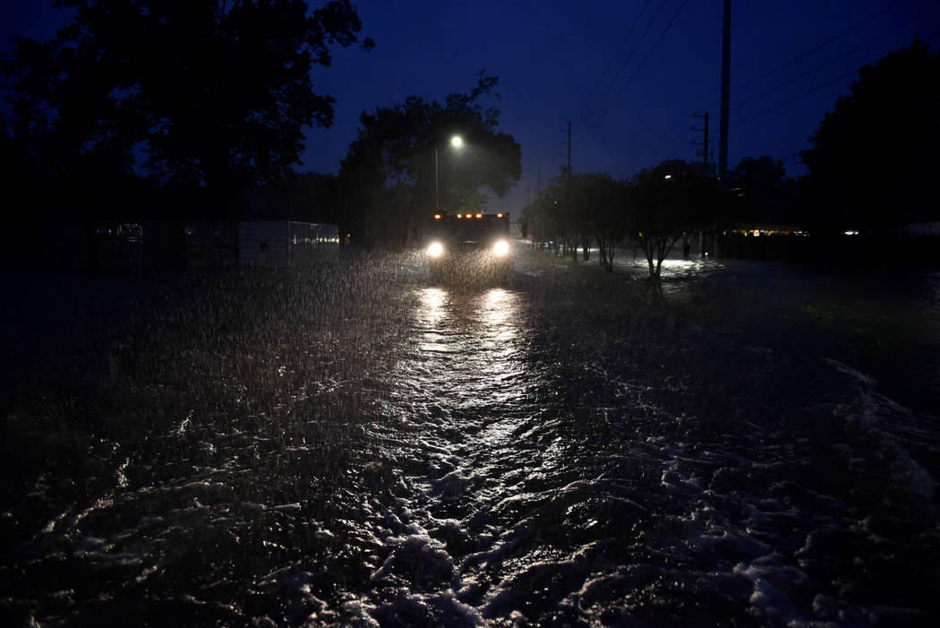 A civilian-owned military vehicle drives through floodwaters performing search and rescue after Hurricane Harvey inundated the Texas Gulf coast with rain causing widespread flooding, in Houston, A ...