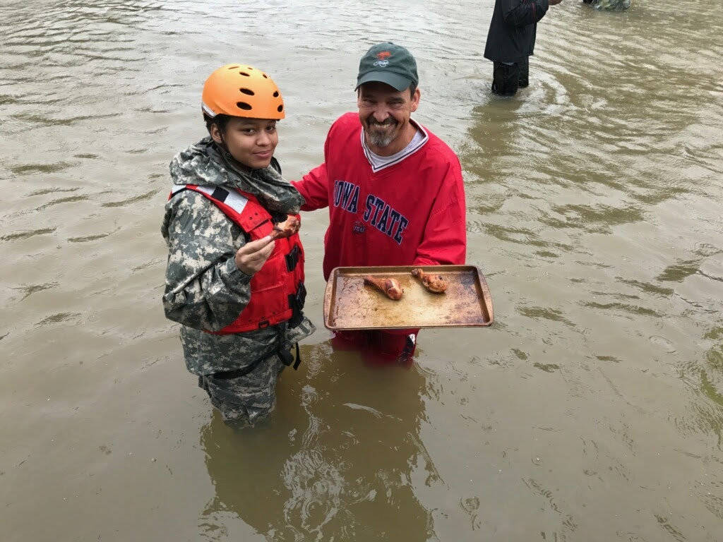 Soldiers with the Texas Army National Guard support relief efforts from the effects of Hurricane Harvey to residents of Cyprus Creek, Texas, U.S., in this handout photo obtained by Reuters August  ...