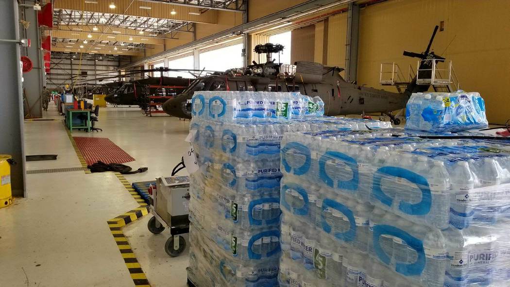 Water and supplies are being sent to recovery areas during Storm Harvey from the Texas Army National Guard Flight Facility in Austin, Aug. 28, 2017. (Texas Military Department/Handout via Reuters)