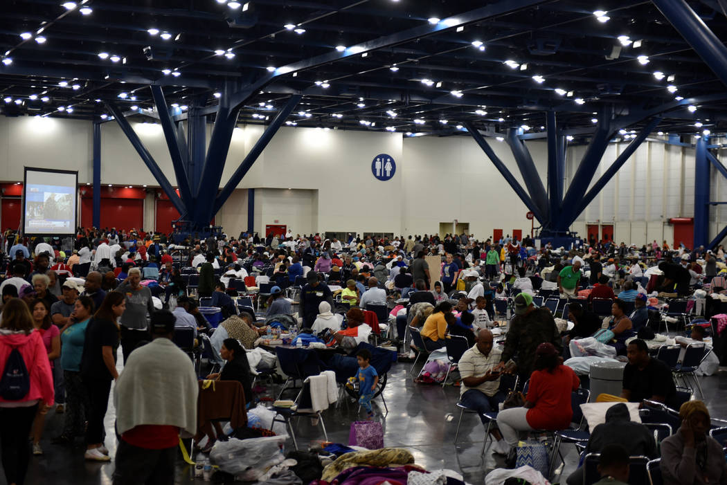Evacuees fill an exhibition hall at the George R. Brown Convention Center where people have taken refuge in Houston, Texas, U.S. August 29, 2017.  REUTERS/Nick Oxford