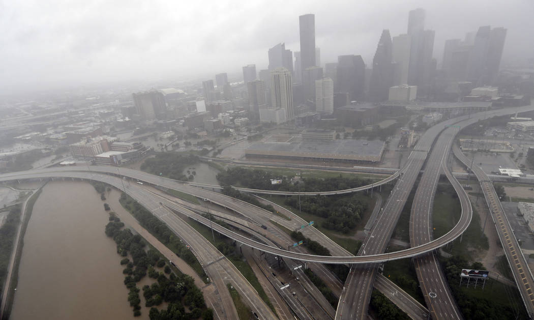 Highways around downtown Houston are empty as floodwaters from Tropical Storm Harvey overflow from the bayous around the city Tuesday, Aug. 29, 2017, in Houston. (AP Photo/David J. Phillip)
