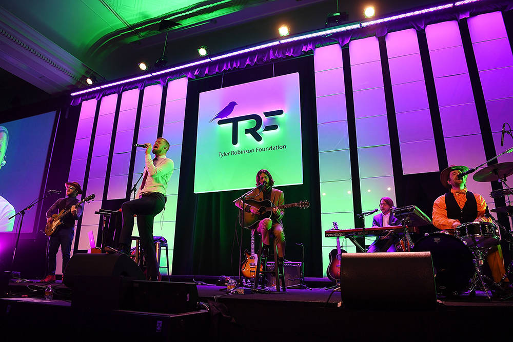 From left, bassist Ben McKee, singer Dan Reynolds, guitarist Wayne Sermon and drummer Daniel Platzman of Imagine Dragons perform at the Tyler Robinson Foundation's fourth annual Believer Gala at C ...