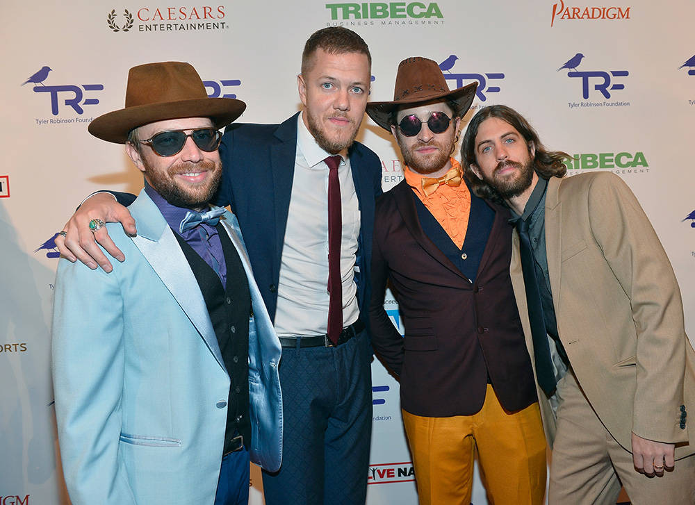 From left, Bassist Ben McKee, singer Dan Reynolds, guitarist Daniel Sermon and drummer Daniel Platzman of Imagine Dragons arrive at the Tyler Robinson Foundation's fourth annual Believer Gala at C ...