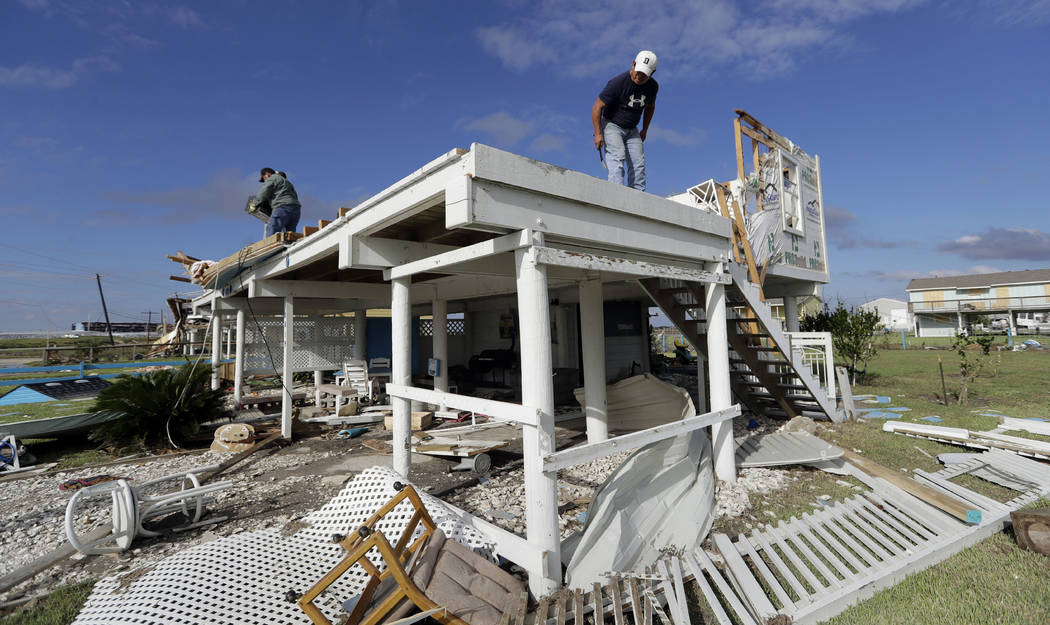Joe Tijerina, right, works to salvage items from his home that was destroyed in the wake of Hurricane Harvey, Tuesday, Aug. 29, 2017, in Rockport, Texas. (Eric Gay/AP)