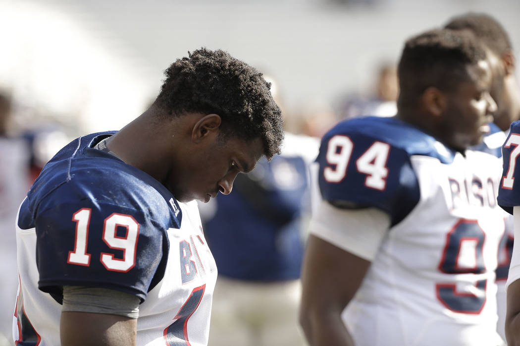 Howard linebacker Elijah Anglin (19) stands on the sideline late in the fourth quarter of their 76-0 loss to Boston College in an NCAA college football game, Saturday, Sept. 12, 2015, in Boston, M ...