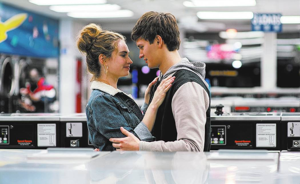 Baby (ANSEL ELGORT) helps Debora (LILY JAMES) do her laundry as they dance around each other and kiss in TriStar Pictures' BABY DRIVER.