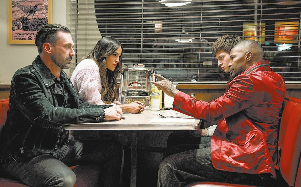 (l to r) Buddy (Jon Hamm), Darling (Eiza Gonzalez), Baby (Ansel Elgort) and Bats (JAMIE FOXX) discuss the next heist in TriStar Pictures' BABY DRIVER.