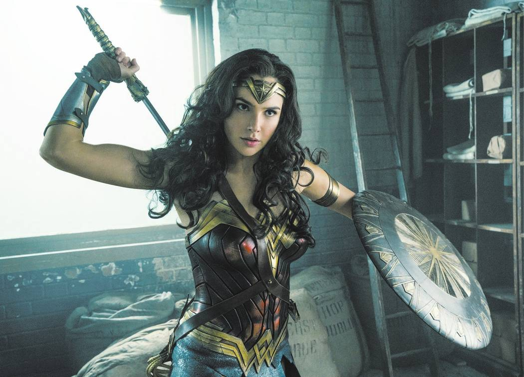 "This image released by Warner Bros. Entertainment shows Gal Gadot in a scene from ""Wonder Woman."" ""Wonder Woman"" wrapped up Tom Cruise's ""The Mummy&#x ..."