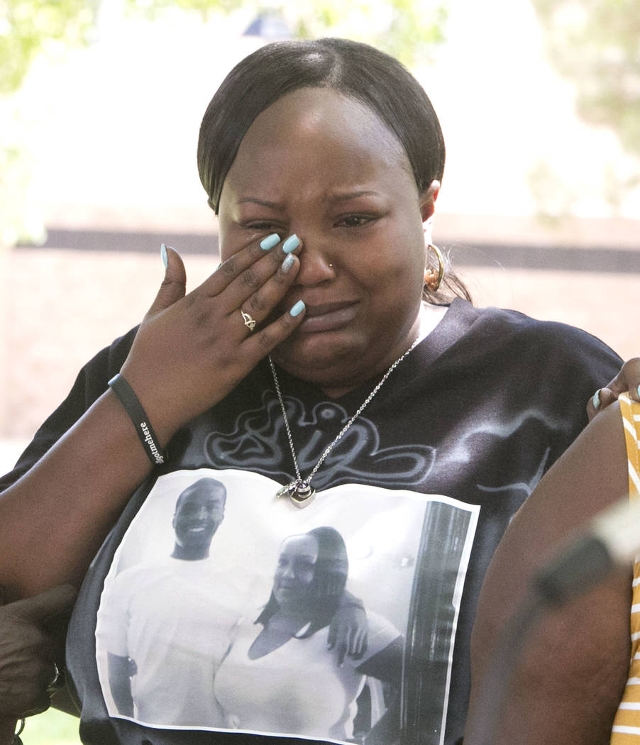 Angela Samuels, sister of homicide victim Eric Brooks, weeps as police and family hold a briefing at the community park at the intersection of Seeliger Street and Vintage Wine Avenue on Tuesday, A ...