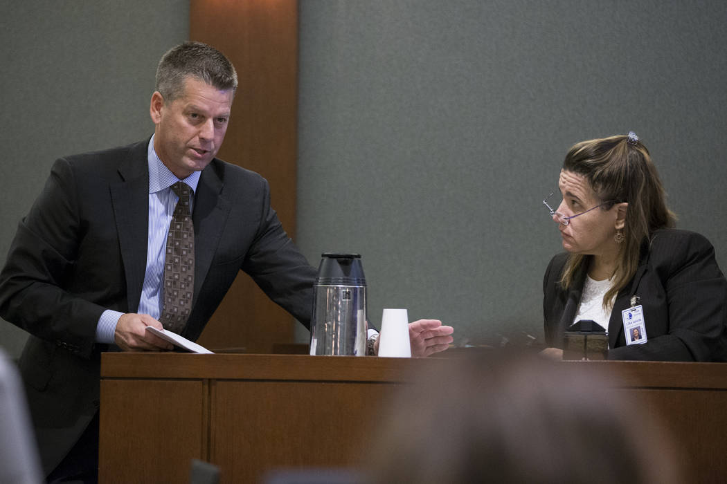 Peter S. Christiansen, left, attorney for Assuan Martinez, a father charged with murder in the death of his infant son, shows evidence to Clark County Medical Examiner Lisa Gavin during his client ...