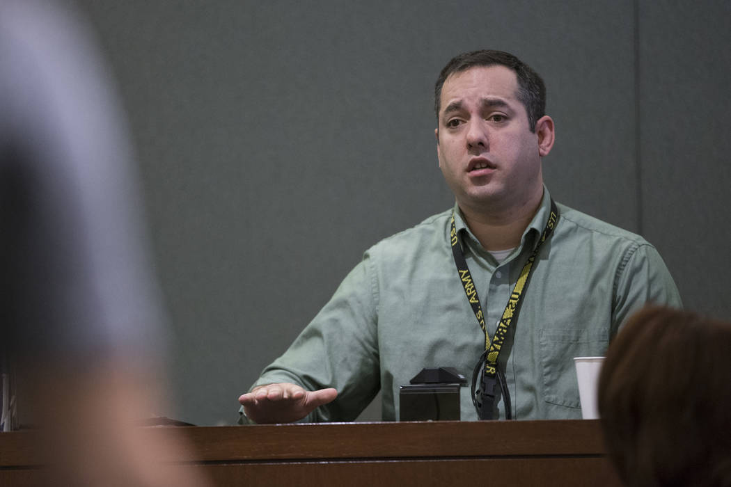 Las Vegas police Detective Christopher Grivas on the witness stand during the preliminary hearing for Assuan Martinez, a father charged with murder in the death of his infant son, at the Regional  ...