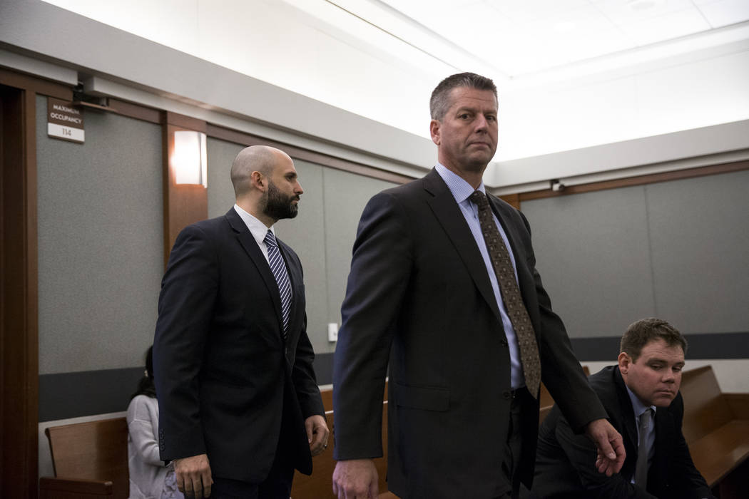 Assuan Martinez, left, who is charged with murder in the death of his infant son, with defense attorney Peter S. Christiansen during his preliminary hearing at the Regional Justice Center in Las V ...
