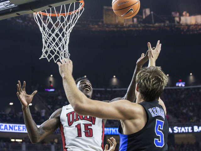UNLV's Dwayne Morgan (15) fights for a rebound with Duke's Luke Kennard (5) during the Blue Devils road matchup with the Rebels at T-Mobile Arena on Saturday, Dec. 10, 2016, in Las Vegas. Benjamin ...