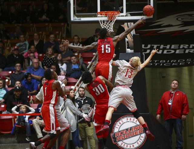 UNLV forward Dwayne Morgan (15) blocks a shot by Southern Utah guard Race Parsons (13) during a basketball game at the Centrum Arena in Cedar City, Utah on Wednesday, Nov. 30, 2016. UNLV won 89-81 ...