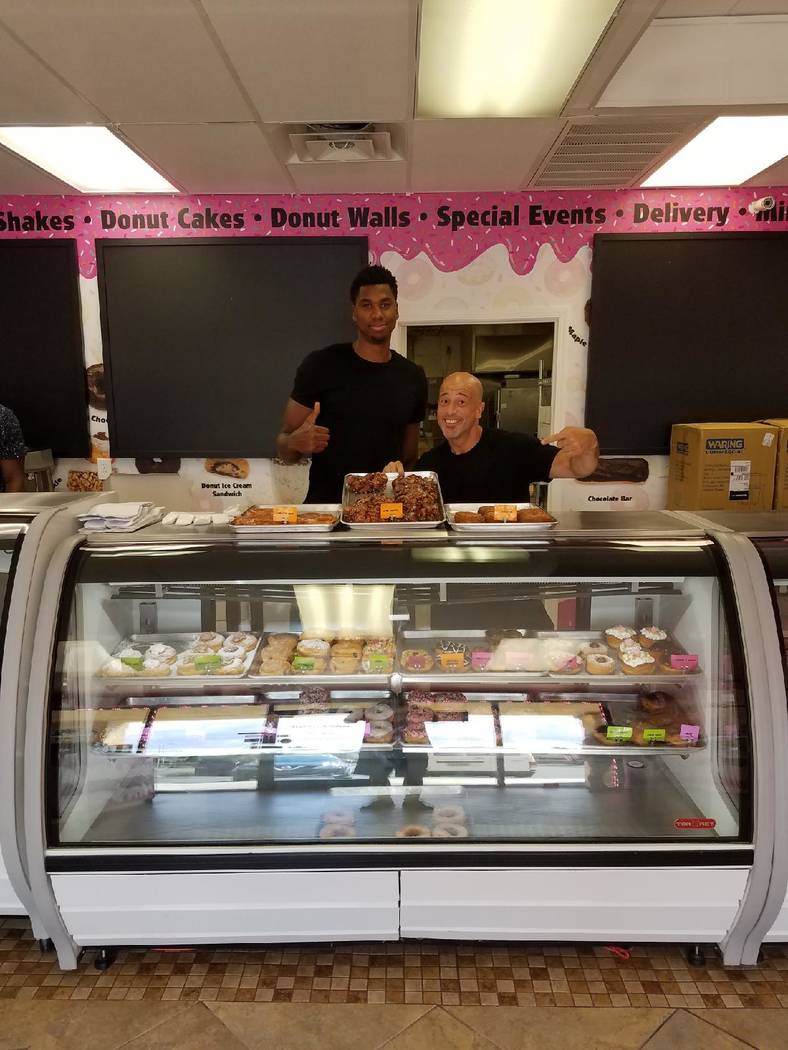 "Hassan Whiteside of the Miami Heat is shown with Brett Raymer of ""Tanked"" at Donut Mania at 4460 S. Durango Dr. Suite D on Monday, Aug. 28, 2017. (Brett Raymer)"