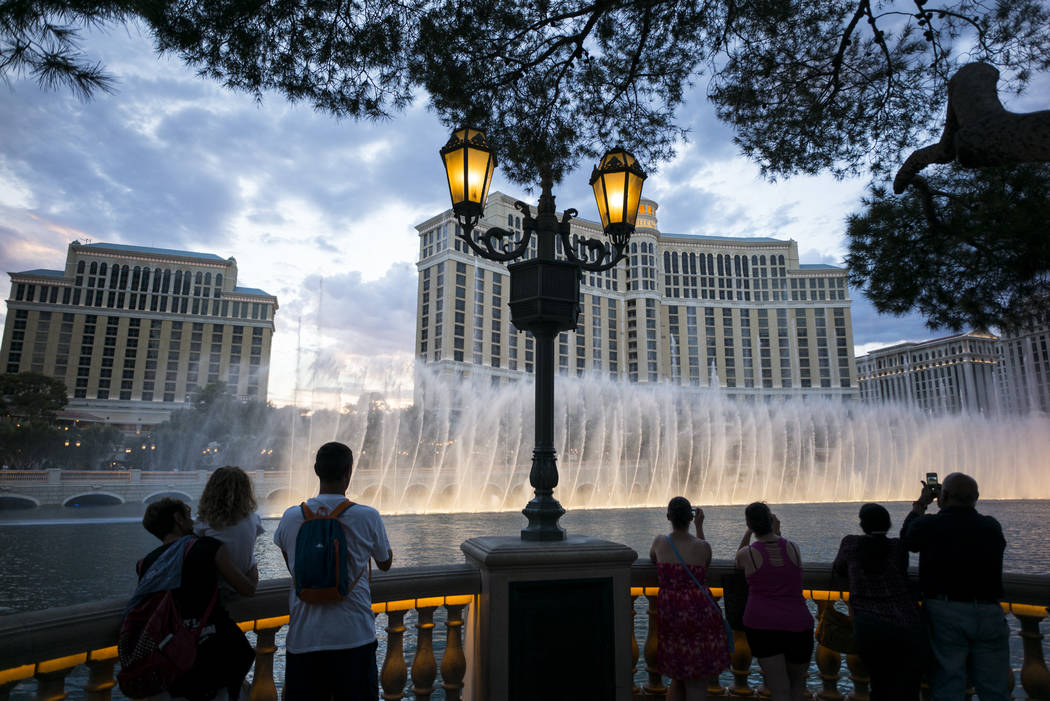 Tourists take in the fountains at the Bellagio in Las Vegas on Wednesday, Aug. 30, 2017. Chase Stevens Las Vegas Review-Journal @csstevensphoto