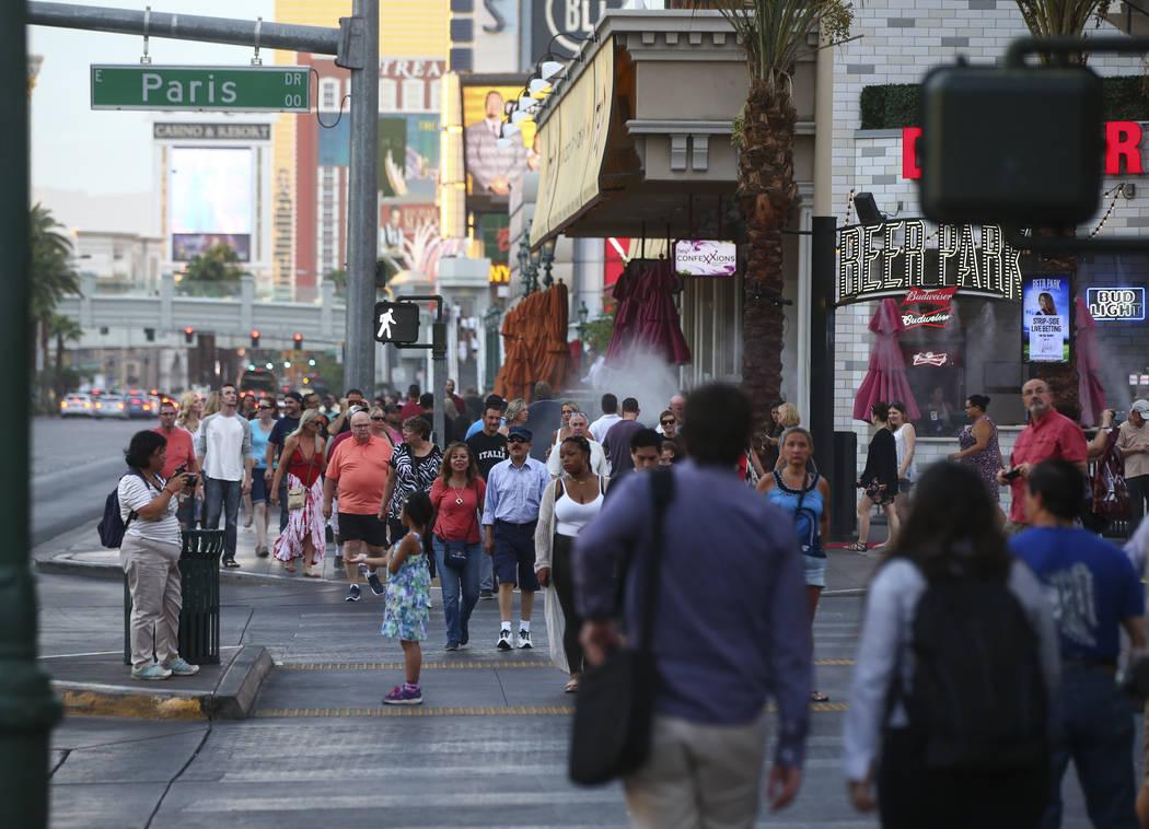 Tourists walk along the Strip outside of Paris Las Vegas on Wednesday, Aug. 30, 2017 in Las Vegas. Chase Stevens Las Vegas Review-Journal @csstevensphoto