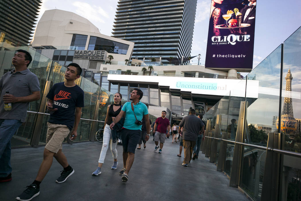 Tourists walk along a pedestrian bridge outside of The Cosmopolitan of Las Vegas on Wednesday, Aug. 30, 2017 in Las Vegas. Chase Stevens Las Vegas Review-Journal @csstevensphoto