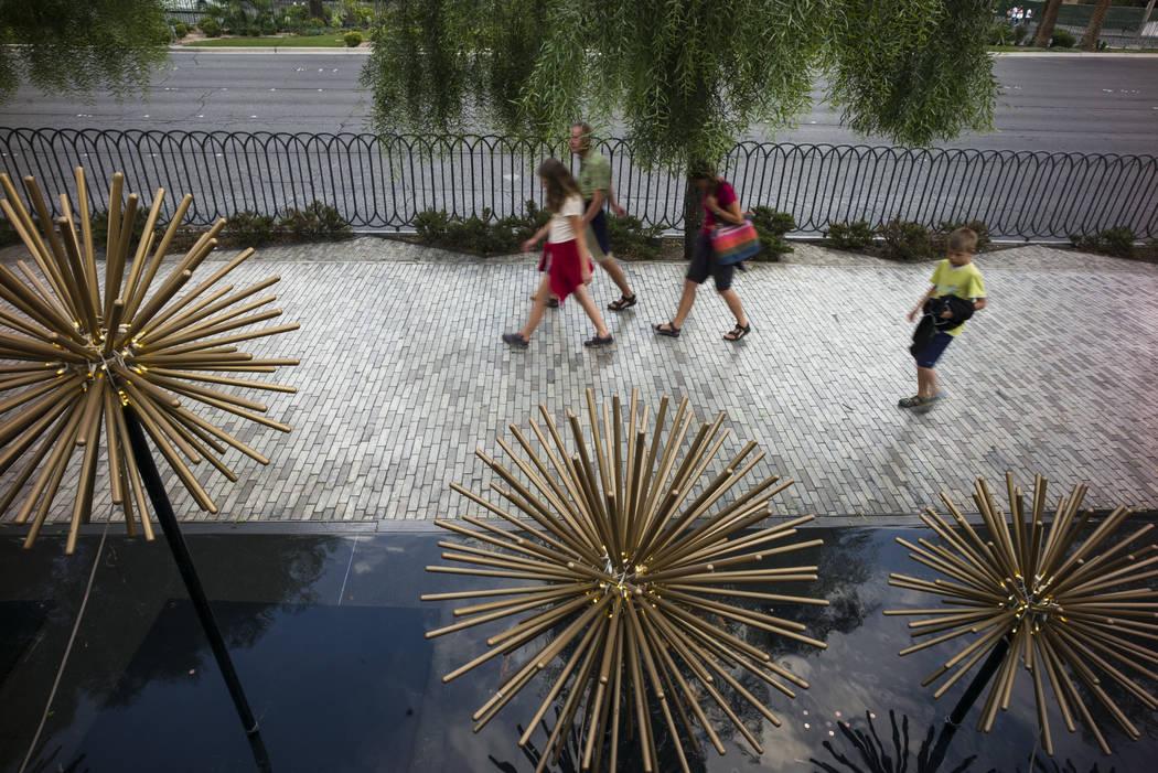Tourists walk along the Strip outside of New York-New York in Las Vegas on Wednesday, Aug. 30, 2017. Chase Stevens Las Vegas Review-Journal @csstevensphoto
