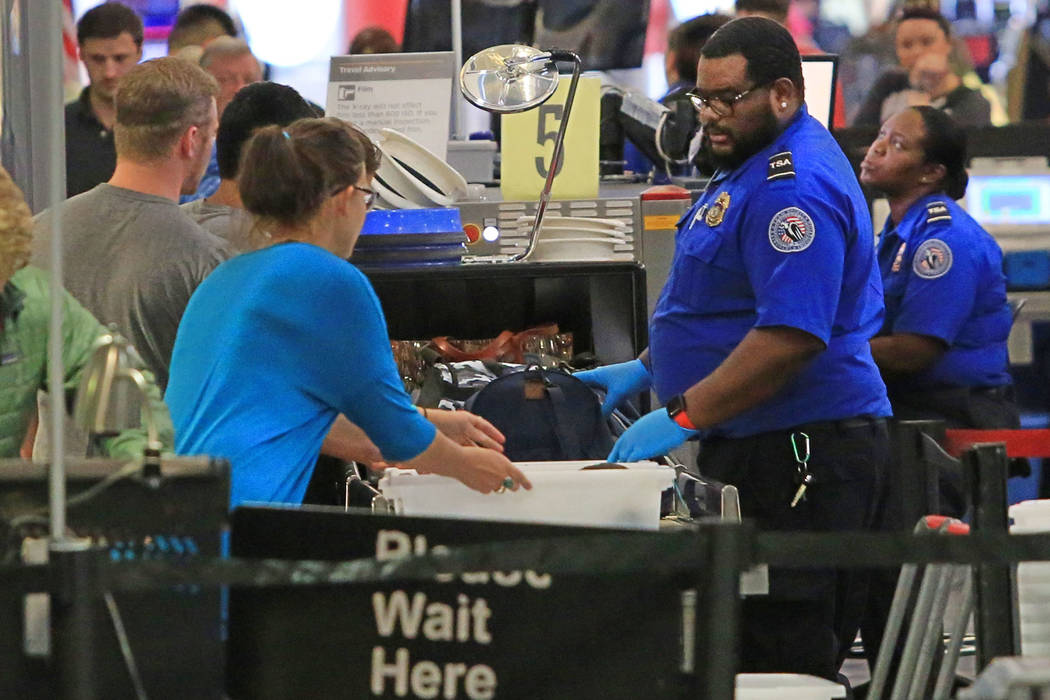 TSA agents check the bags of travelers at McCarran International Airport in Las Vegas on Thursday, March 30, 2017. (Brett Le Blanc/Las Vegas Review-Journal) @bleblancphoto