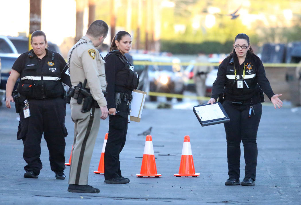 Metro investigates a double homicide in the 4100 block of Silver Dollar Avenue on Tuesday, June 13, 2017, in Las Vegas. (Bizuayehu Tesfaye/Las Vegas Review-Journal) @bizutesfaye