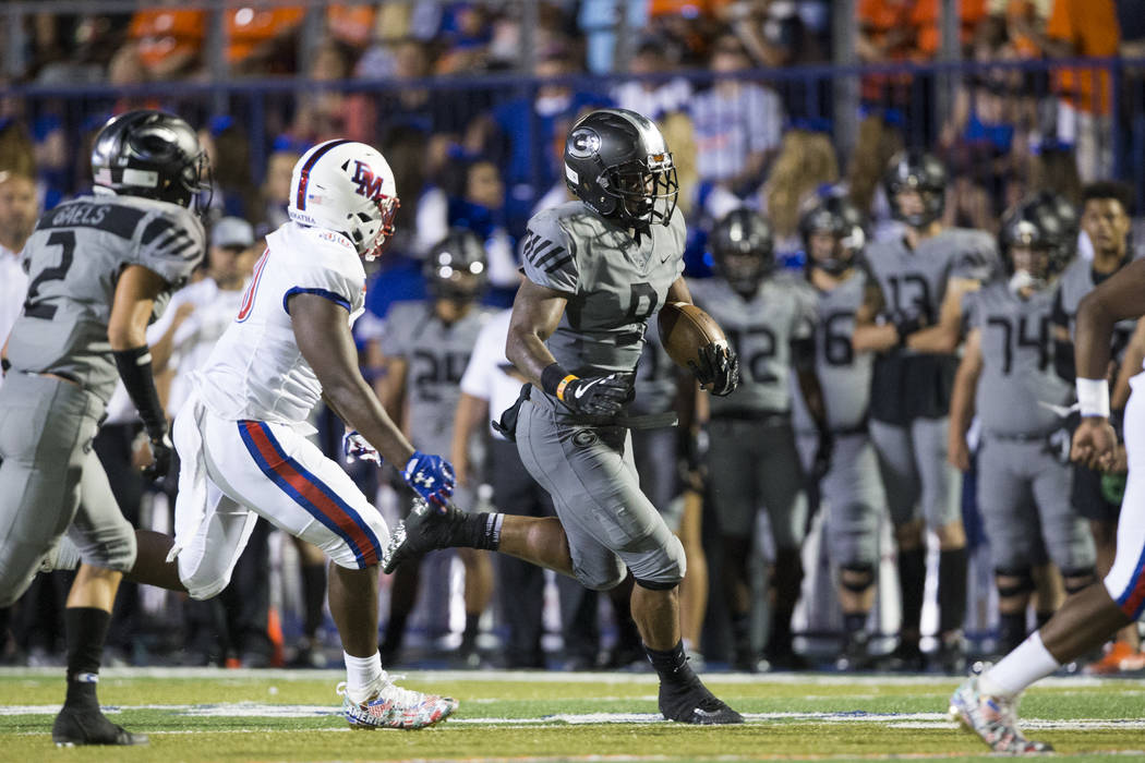 Bishop Gorman's Brevin Jordan (9) runs for a touchdown against DeMatha Catholic in their football game at Bishop Gorman High School in Las Vegas, on Friday, Aug. 25, 2017. Gorman won 35-23. Erik V ...