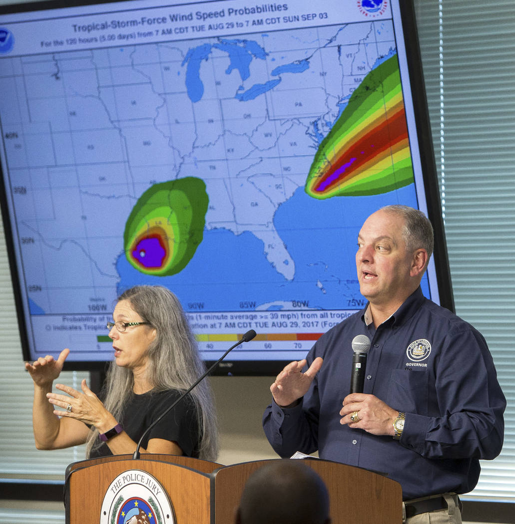 Louisiana Governor, John Bel Edwards, speaks to officials from the 5 parishes the SW Louisiana during a weather debriefing at the Office of Emergency Preparedness in Lake Charles, La., Tuesday, Au ...