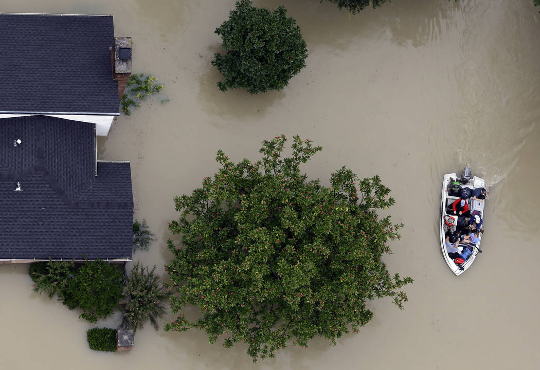 Residents evacuate their homes near the Addicks Reservoir as floodwaters from Tropical Storm Harvey rise Tuesday, Aug. 29, 2017, in Houston. (David J. Phillip/AP)