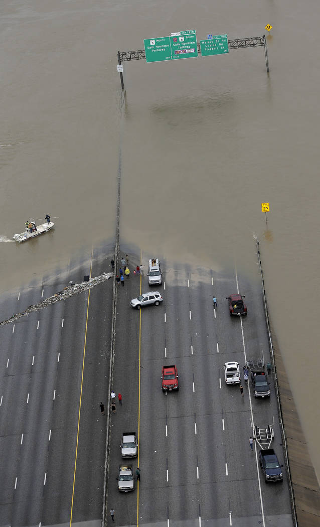 Interstate 10 is closed due to floodwaters from Tropical Storm Harvey Tuesday, Aug. 29, 2017, in Houston. (David J. Phillip/AP)