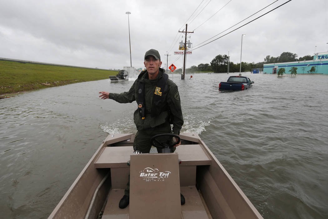Lt. Beau Robertson, of the Louisiana Department of Wildlife and Fisheries, navigates through floodwaters from Tropical Storm Harvey during search and rescue operations in Orange, Texas, Wednesday, ...