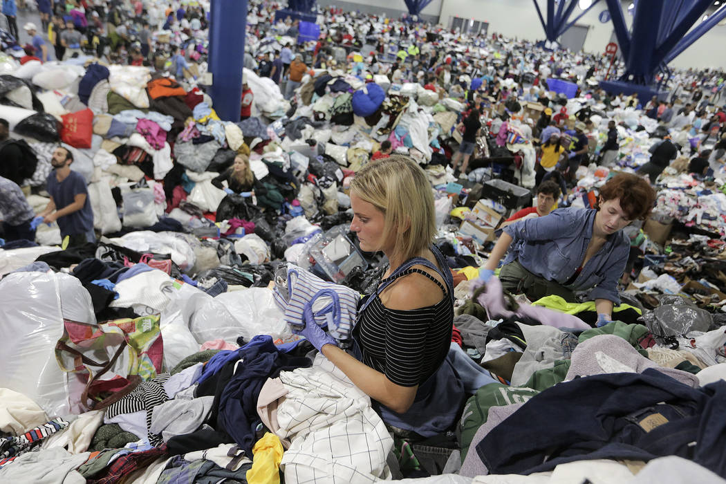 Kathryn Loder sorts donated clothing at George R. Brown Convention Center in Houston as Tropical Storm Harvey inches its way through the area on Tuesday, Aug. 29, 2017. ( Elizabeth Conley/Houston  ...
