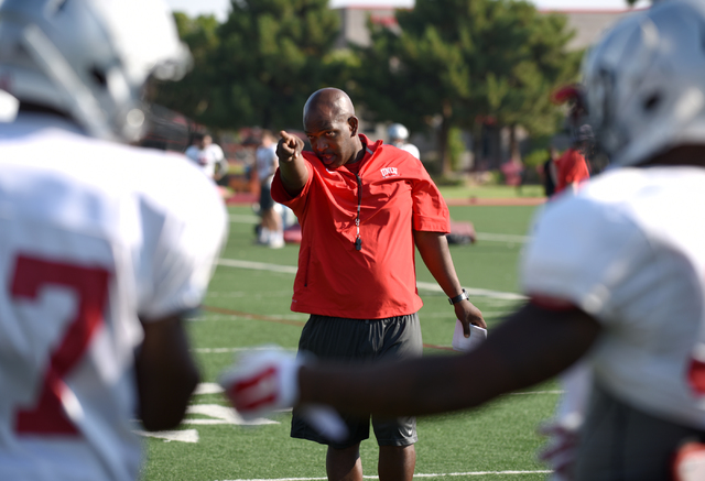 Wide receiver coach Cedric Cormier teaches receiver techniques during football practice at Rebel Park inside the UNLV campus in Las Vegas on Thursday, Aug. 25, 2016. (Martin S. Fuentes/Las Vegas R ...