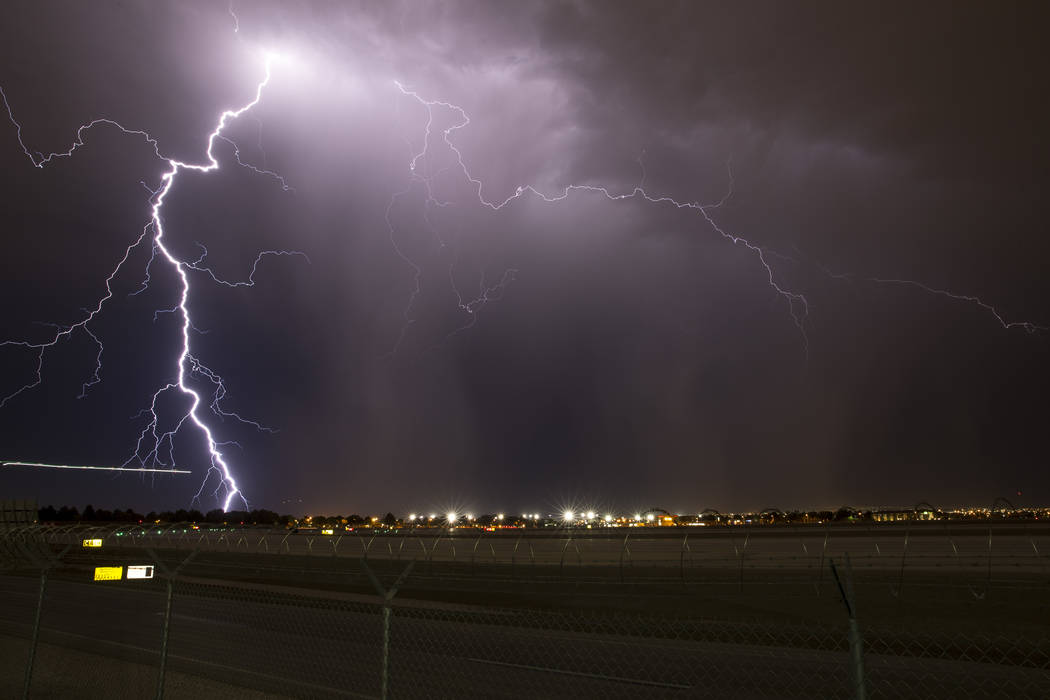 Lightning strikes as a storm makes its way through the Las Vegas Valley on Wednesday, Aug. 30, 2017, as seen from McCarran International Airport. Richard Brian Las Vegas Review-Journal @vegasphoto ...