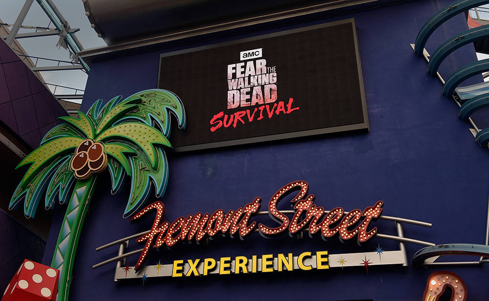 "A video monitor displays the grand opening of downtown Las Vegas' newest entertainment destination, ""Fear The Walking Dead Survival"" at the Fremont Street Experience, Aug. 29. The zombie-themed wa ..."