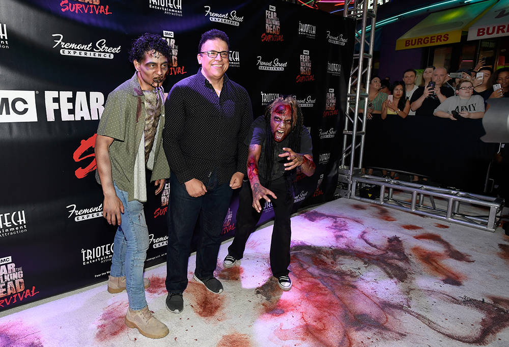 "Triotech president and CEO Ernest Yale, center, arrives at the grand opening of downtown Las Vegas' newest entertainment destination, ""Fear The Walking Dead Survival."" (David Becker/Las Vegas News ..."