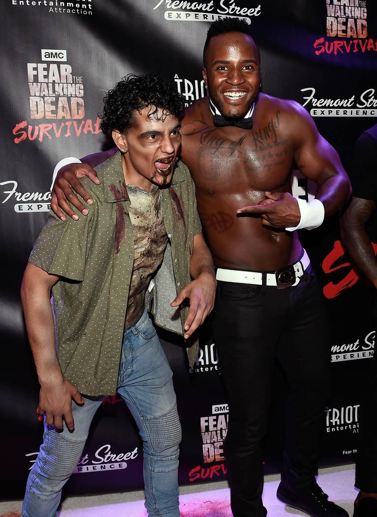 "Chippendales dancer Okewa Garrett, right, arrives at the grand opening of downtown Las Vegas' newest entertainment destination, ""Fear The Walking Dead Survival."" (David Becker/Las Vegas News Bureau)"