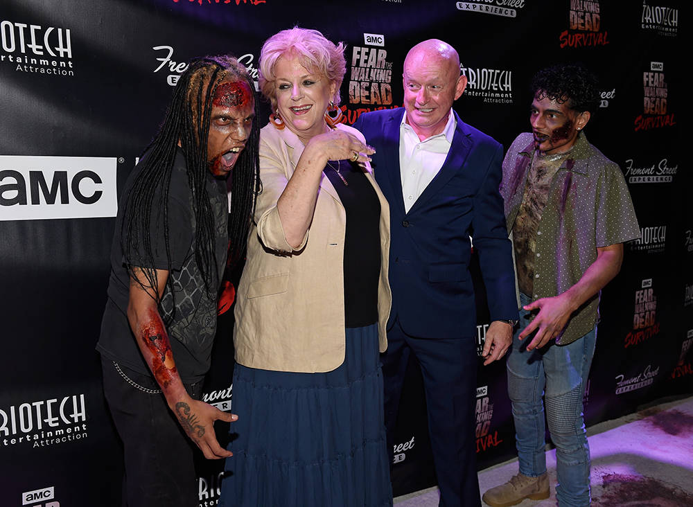 "Las Vegas Mayor Carolyn Goodman and Fremont Street Experience President and CEO Patrick Hughes arrive at the grand opening of downtown Las Vegas' newest entertainment destination, ""Fear The Walkin ..."