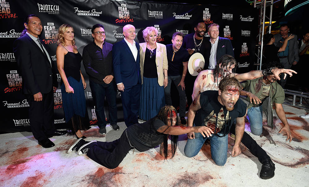 From left, actor Michael Greyeyes, actress Kim Dickens, Triotech President and CEO Ernest Yale, Fremont Street Experience President and CEO Patrick Hughes, Las Vegas Mayor Carolyn Goodman, televis ...