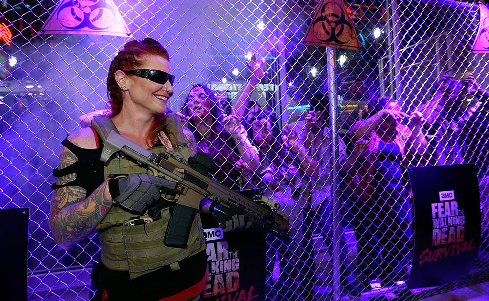 "A model acts as a guard of zombies at the grand opening of downtown Las Vegas' newest entertainment destination, ""Fear The Walking Dead Survival.""  (David Becker/Las Vegas News Bureau)"