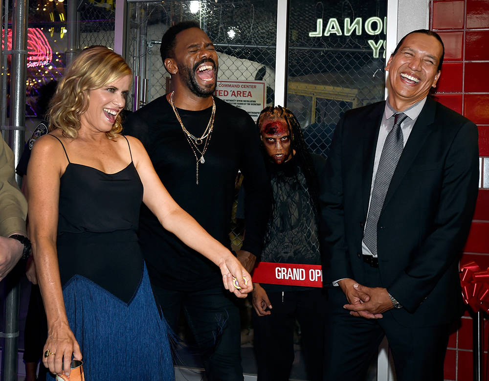 "Actors Kim Dickens, left, Coleman Domingo and Michael Greyeyes share a laugh at the grand opening of downtown Las Vegas' newest entertainment destination, ""Fear The Walking Dead Survival.""  (David ..."