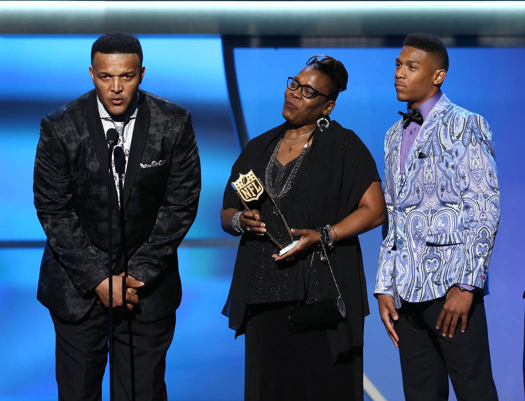 Cecil Newton, Sr., from left, Jackie Newton, and Caylin Newton accept on behalf of Cam Newton of the Carolina Panthers, the AP offensive player of the year presented by Microsoft at the 5th annual ...