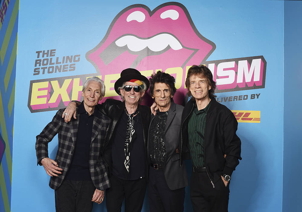 """From left, Charlie Watts, Keith Richards, Ronnie Wood and Mick Jagger of The Rolling Stones pose during a preview of """"The Rolling Stones: Exhibitionism"""" at Saatchi Gallery on April 4, 2016. in Lon ..."""