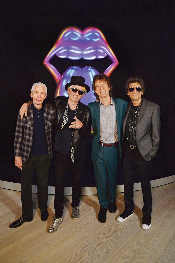 """From left, Charlie Watts, Keith Richards, Mick Jagger and Ronnie Wood of The Rolling Stones pose for a photo during a preview of """"The Rolling Stones: Exhibitionism"""" at Saatchi Gallery in London.   ..."""