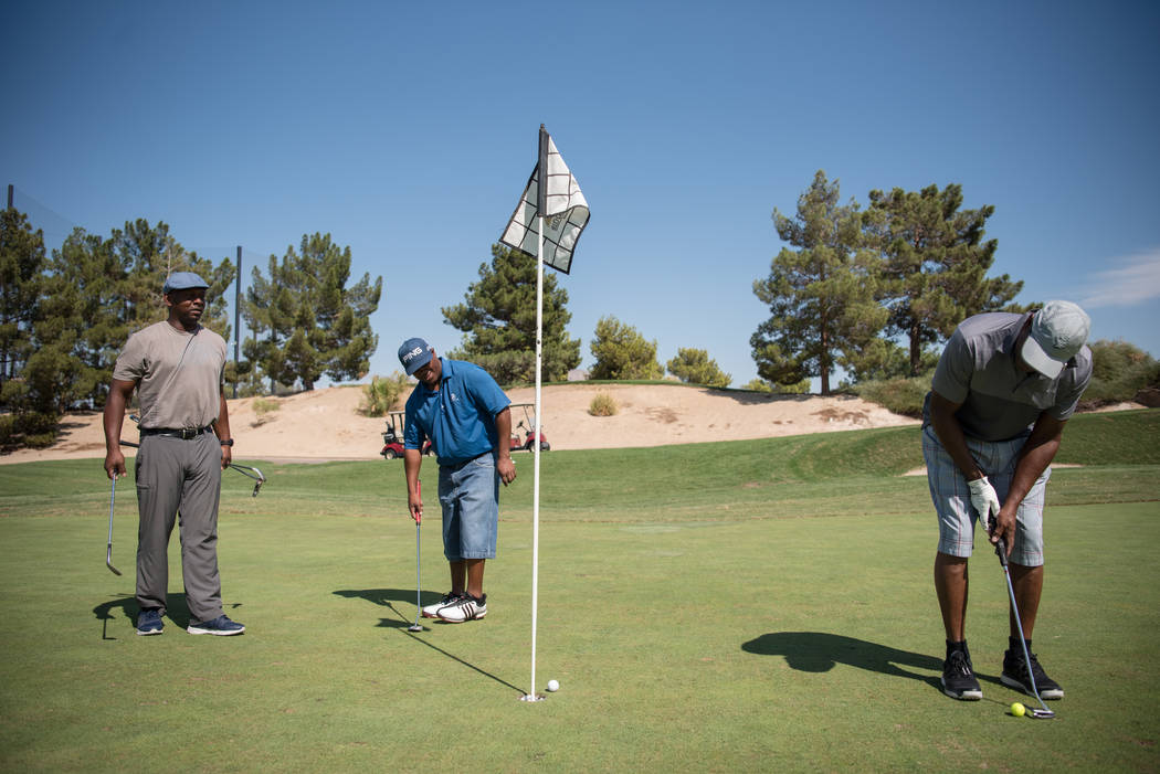 Michael Slocum, left, Marcus Smith, and Phillip Williams, right, play a game of afternoon golf at Desert Pines Golf Course on Wednesday, Aug. 30, 2017, in Las Vegas. Morgan Lieberman Las Vegas Rev ...