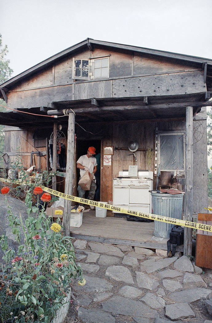 Federal agents gather evidence Aug. 31, 1992, from the home of captured fugitive Randy Weaver near Naples, Idaho. (Gary Stewart/File, AP)