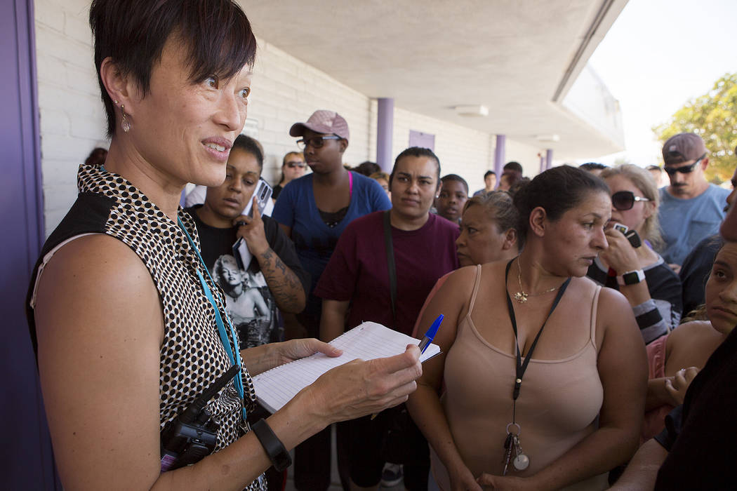 Principal Immer Liza Ravalo takes names to release students to parents and guardians at Dell H. Robison Middle School on Wednesday, Aug. 30, 2017. Bridget Bennett Las Vegas Review-Journal @bridget ...