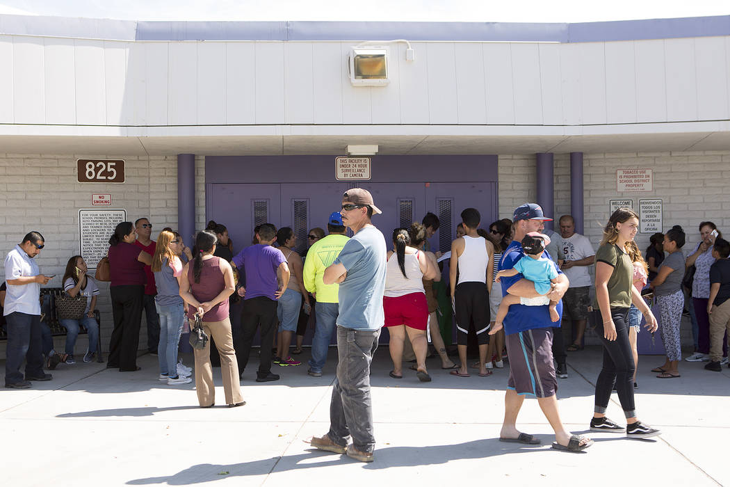Parents and guardians wait for their children to be released at Dell H. Robison Middle School on Wednesday, Aug. 30, 2017. Bridget Bennett Las Vegas Review-Journal @bridgetkbennett