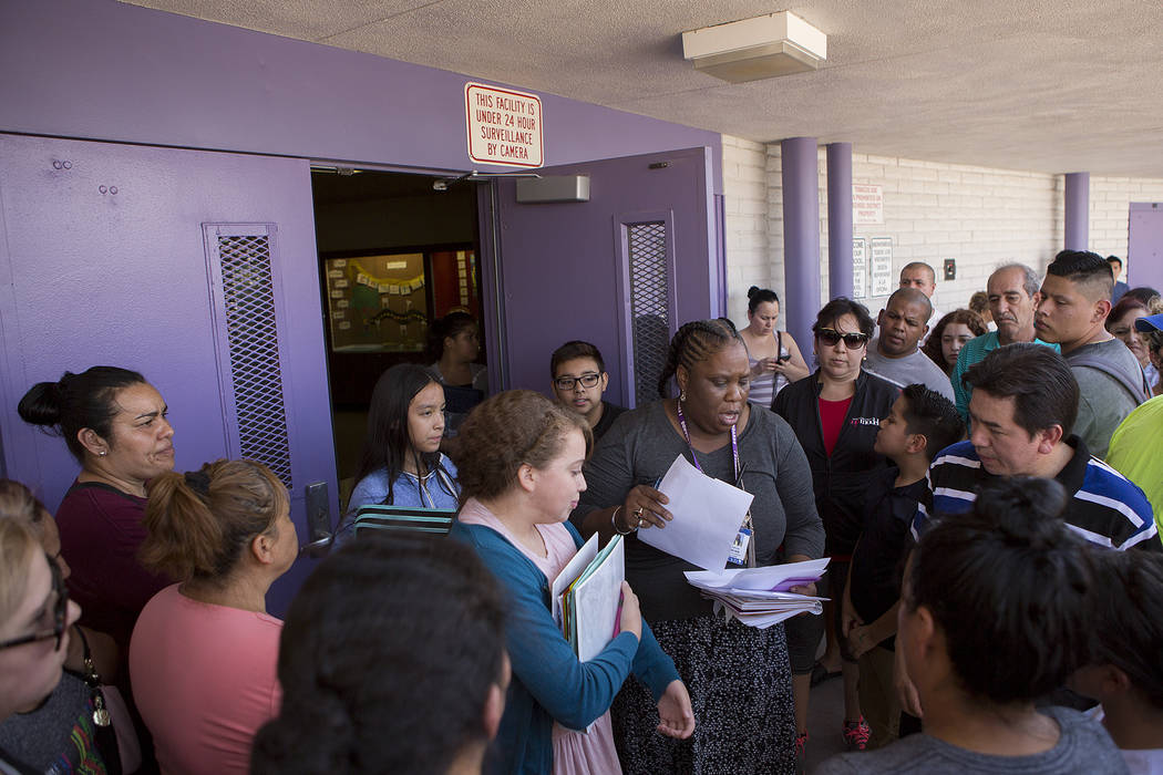 Dean of students Valencia Meyer, center, releases students to parents and guardians that are present at Dell H. Robison Middle School on Wednesday, Aug. 30, 2017. Bridget Bennett Las Vegas Review- ...
