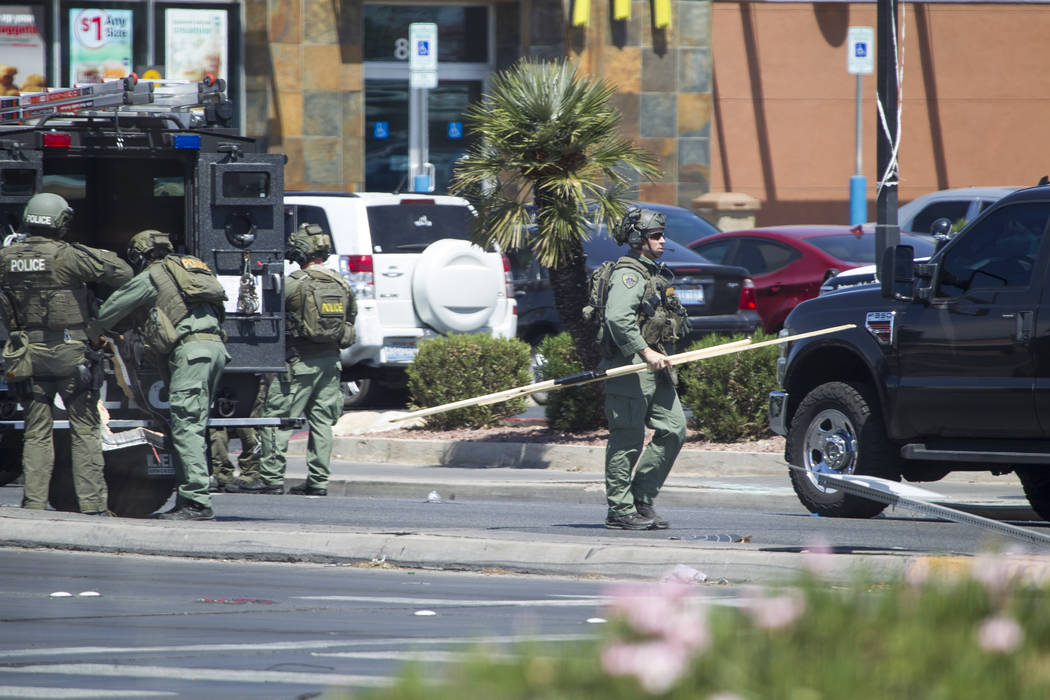 Las Vegas police investigate an incident where a man fired a gun on a Regional Transportation Commission bus at 836 N. Nellis Blvd. on Wednesday, Aug. 30, 2017, in Las Vegas. Richard Brian Las Veg ...