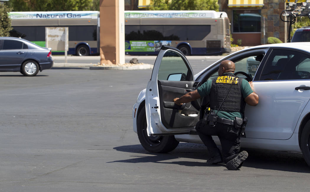 A Deputy Sheriff takes guard after a man fired a gun on a Regional Transportation Commission bus at 836 N. Nellis Blvd. on Wednesday, Aug. 30, 2017, in Las Vegas. Richard Brian Las Vegas Review-Jo ...